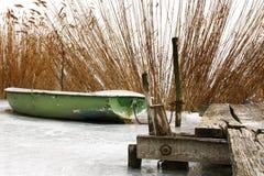 Angler boat on ice at Lake Balaton Royalty Free Stock Photography