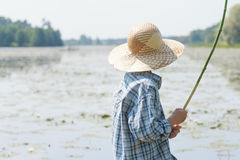 Angler boy is chumming handmade fishing rod Stock Photography