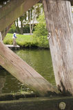 Angler by the bridge Royalty Free Stock Image
