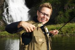 Angler with Brown trout. Female Angler with brown trout stock image