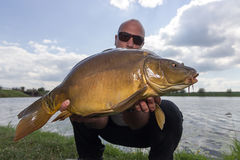 Angler with carp fishing trophy Carp and Fisherman, Carp fishing trophy Stock Photos