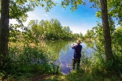 Angler. Catching the fish during summer day royalty free stock image