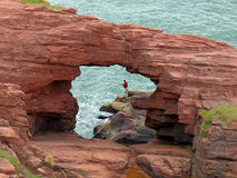 Angler on the cliffs. Young man is fishing on cliffs in Arbroath, Scotland Stock Photos