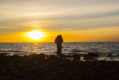 Angler at the coast Stock Photography