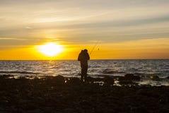 Angler at the coast Stock Photography