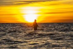 Angler at the coast Stock Photos