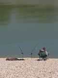 Angler Enjoying Peace At Lake Shore Royalty Free Stock Images