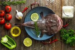 Angler fish. On a wooden board Royalty Free Stock Photos