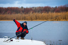 Angler. A fisherman with a fishing rod on the river bank stock image