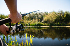 Angler fishing in river Royalty Free Stock Photos