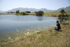 Angler fly fishing South Africa royalty free stock images