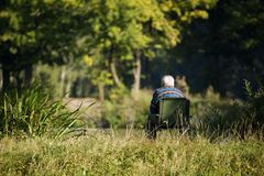 Angler in the forrest. Angler sitting in the forrest in the sun. Canon 5D, 100-400L Royalty Free Stock Image