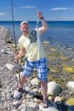 Angler with garfish. Fishing garfish on Swedish coast stock images