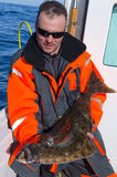 Angler with halibut Stock Photos