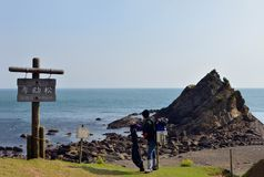 An angler and the Japanese mountain and sea. Royalty Free Stock Images