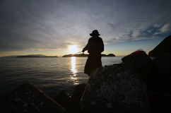 An angler and the Japanese sea. In Wakayama royalty free stock photography