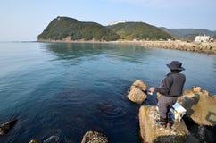 An angler and the Japanese sea. An angler and the Japanese sea in wakayama Japan stock photos