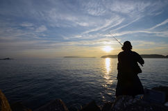 An angler and the Japanese sea. An angler and the Japanese sea in wakayama Japan stock photo