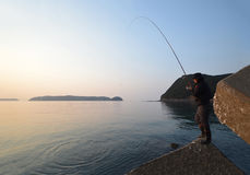 An angler and the Japanese sea. An angler and the Japanese sea in wakayama Japan royalty free stock photos