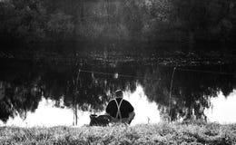 Angler. Man angling on the bank of river royalty free stock photo