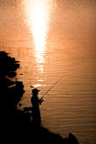 Angler. Man standing on fishing are silhouette. Country life is beautiful royalty free stock photography