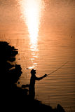 Angler. Man standing on fishing are silhouette. Country life is beautiful stock photo