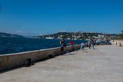 Angler Men are fishing at Beylerbeyi Seashore, Bosphorus, Blue Sky. Angler Men are fishing at Beylerbeyi Seashore, Bosphorus. Blue Sky. Beylerbeyi is located the stock photo
