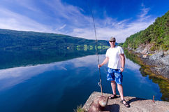 Angler and Norwegian fjord Stock Images