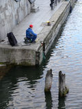 Angler in old port Stock Photos