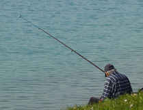 Angler Pensioner. Old angler fishing on the lake stock photo