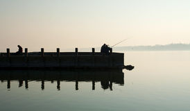 Angler on the pier at Lake Balaton Royalty Free Stock Photos