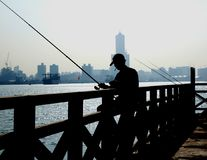 Angler in the port city of Kaohsiung Stock Image