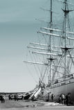 Angler and sailing ship Royalty Free Stock Images