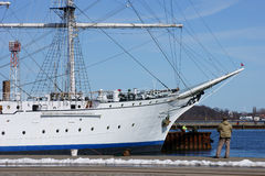 Angler and sailing ship. The harbor of Stralsund stock images