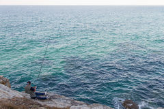 Angler on the Sea Coast Royalty Free Stock Photos
