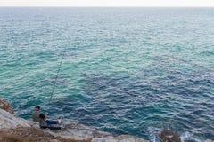 Angler on the Sea Coast Royalty Free Stock Photos