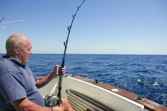 Angler senior big game sport fishing boat Stock Images
