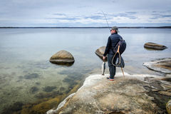 Angler on spring sea coast Royalty Free Stock Photography