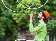 Angler on the street is playing with colorful rings. Auckland city, New Zealand. Stock Images