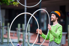 Angler on the street is playing with colorful rings. Auckland city, New Zealand. Royalty Free Stock Photos