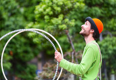 Angler on the street is playing with colorful rings. Auckland city, New Zealand. Royalty Free Stock Images