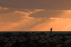 Angler at sunset Royalty Free Stock Photo