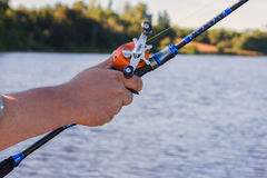 Angler use multiplier fishing reel Stock Image