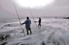 Anglers cought by the tide Royalty Free Stock Photos