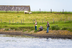 Anglers fishing off of Spui river, Netherlands Royalty Free Stock Images