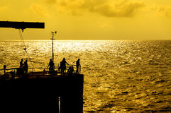 Anglers at jetty Stock Photography