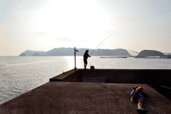 Anglers in the main island of Southernmost Japan. An anglers in the main island of Southernmost Japan Royalty Free Stock Photo