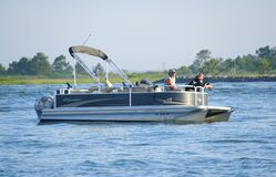 Free Anglers On The Pontoon Boat Fishing For Flounder Near Indian River Inlet In The Stock Photos - 188017893