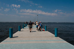 Anglers on a Seaside Fishing Pier Stock Photography