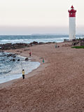 Anglers on the Umhlanga Rocks beachfront near Lighthouse. DURBAN, SOUTH AFRICA - JULY 11, 2016: Anglers on the Umhlanga Rocks beachfront near Lighthouse Stock Image